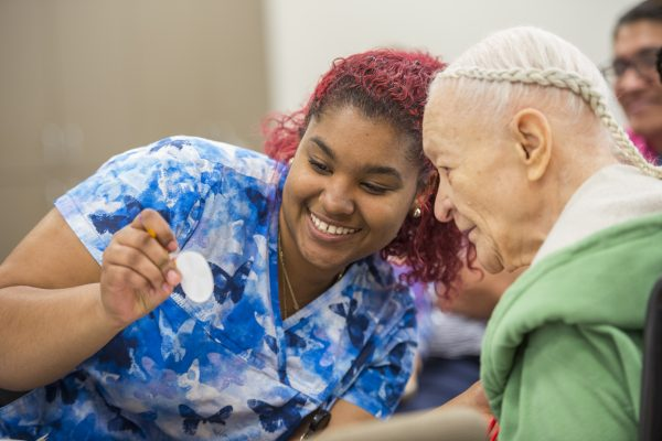 A caregiver with a PACE participant at the InnovAge PACE Center in San Bernadino, California