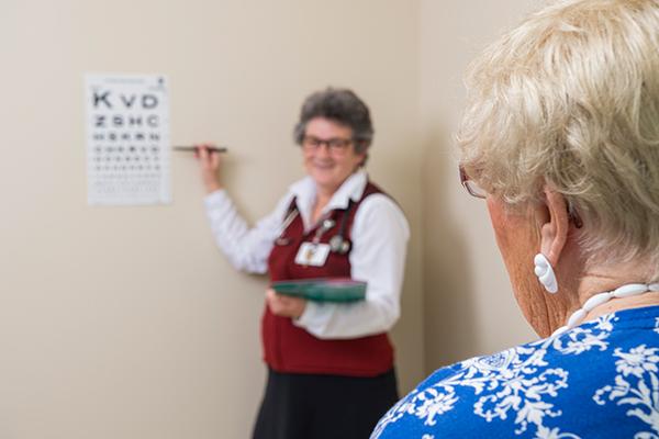 A PACE participant takes a vision test